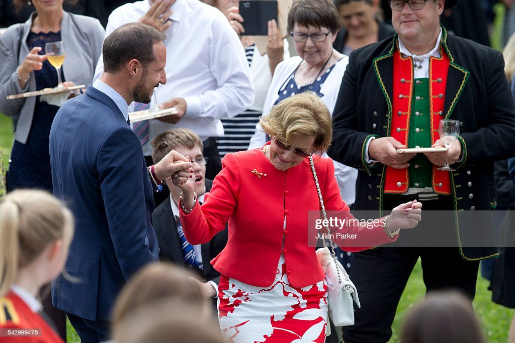 Queen Sonja of Norway has an impromptu dance with her son Crown Prince Haakon of Norway at a Garden Party at the Royal Residence of Gamlehaugen, on a visit to Bergen, during the King and Queen of Norway's Silver Jubilee Tour, on June 25, 2016 in Bergen, Norway.