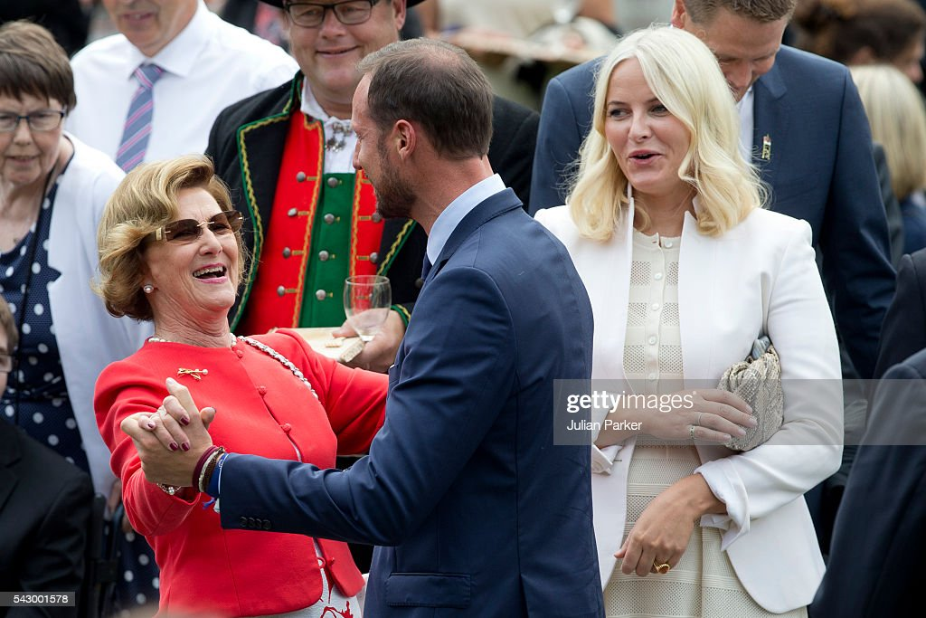 Queen Sonja of Norway has an impromptu dance with her son Crown Prince Haakon of Norway, watched by Crown Princess Mette-Marit of Norway at a Garden Party at the Royal Residence of Gamlehaugen, on a visit to Bergen, during the King and Queen of Norway's Silver Jubilee Tour, on June 25, 2016 in Bergen, Norway.