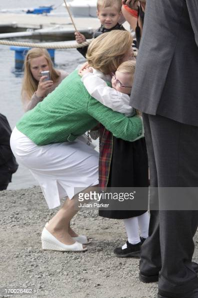 Queen Sonja of Norway is greeted by 4 year old Eyla Cyone on her arrival at the quayside in Afjordon the last day of a three day visit to the county...