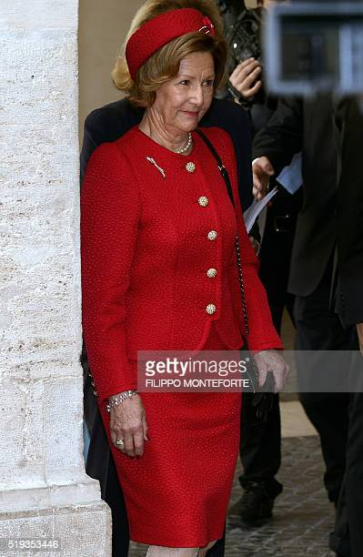 Queen Sonja of Norway walks towards her husband King Harald of Norway and Italy's Prime Minister Matteo Renzi at Rome's Palazzo Chigi on April 6 2016...