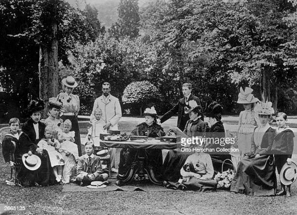 Queen Victoria surrounded by members of the royal family at Osborne House on the Isle of Wight From left to right Prince Leopold of Battenberg...