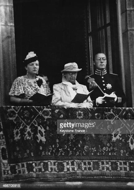 Queen Wilhelmina Princess Juliana and Prince Bernhard are reading the texts that choirs are singing for the Queen Jubilee in The Hague Netherlands