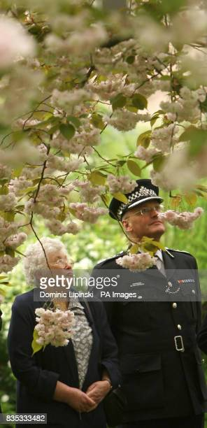 Queenie Fletcher the mother of PC Yvonne Fletcher speaks to Metropolitan Police Chief Commissioner Sir Paul Stephenson underneath the branches of a...