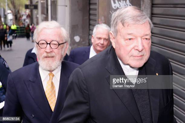Queens Counsel Robert Richter walks with his client Cardinal George Pell from his office to the Melbourne Magistrates' Court on October 6 2017 in...