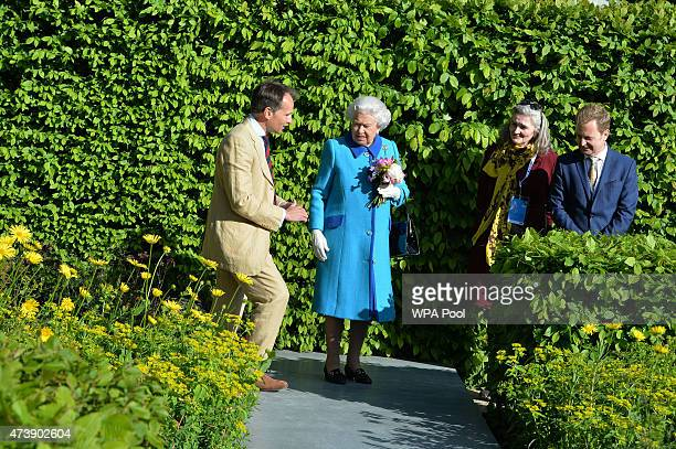 Queens Elizabeth II is shown the Telegraph Garden by designer Marcus Barnett at the annual Chelsea Flower show at Royal Hospital Chelsea on May 18...