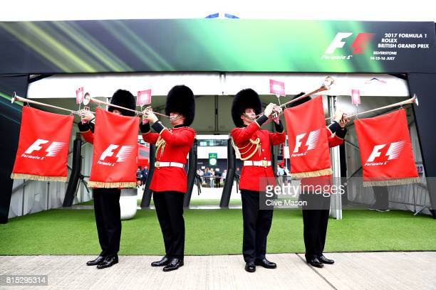 Queens Guards in traditional bearskin hats play horns at the paddock entrance before the Formula One Grand Prix of Great Britain at Silverstone on...