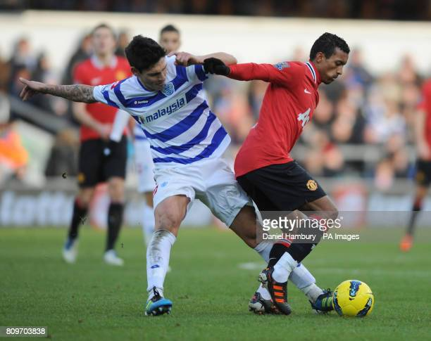 Queens Park Rangers' Alejandro Faurlin and Manchester United's Nani battle for the ball during the Barclays Premier League match at Loftus Road London