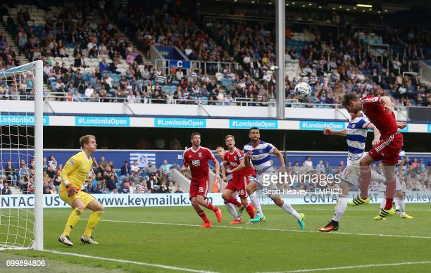 Queens Park Rangers' Alex Smithies saves a shot from Birmingham City's Jonathan Grounds