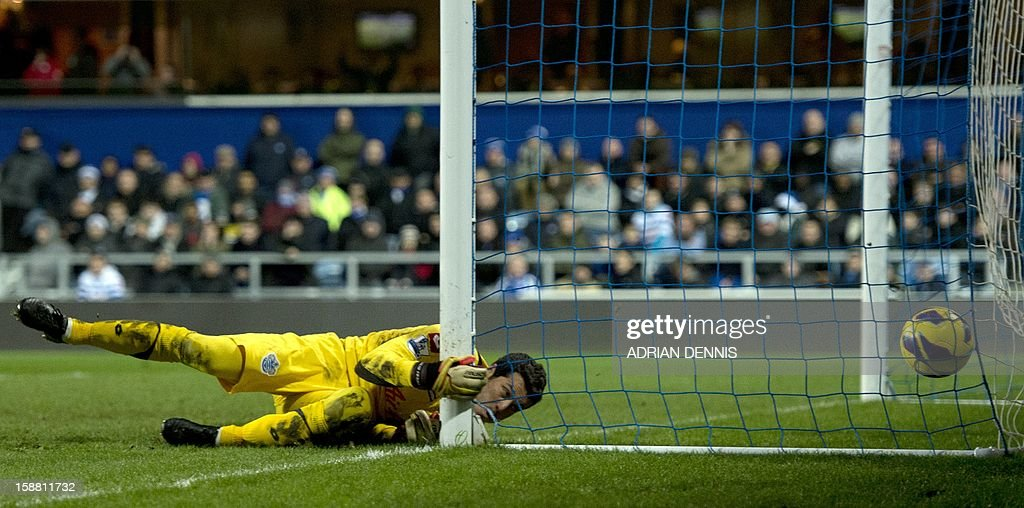 """Queens Park Rangers' Brazilian goalkeeper Julio Cesar watches as the ball hits the back of the net for Liverpool's third goal by Daniel Agger (not pictured) during the Premiership match at Loftus Road in London on December 30, 2012. USE. No use with unauthorized audio, video, data, fixture lists, club/league logos or """"live"""" services. Online in-match use limited to 45 images, no video emulation. No use in betting, games or single club/league/player publications."""