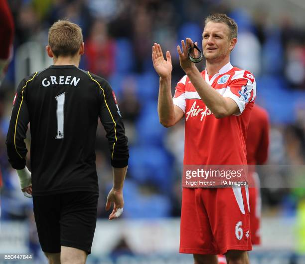Queens Park Rangers' Captain Clint Hill applauds the traveling fans after his side relegation during the Barclays Premier League match at the...