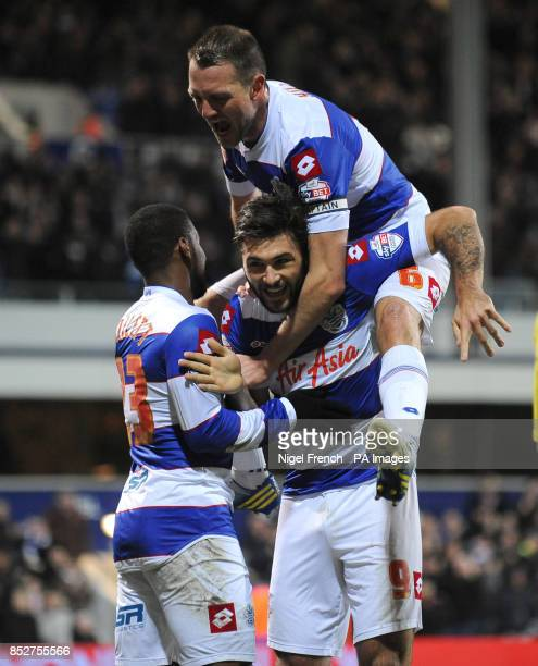 Queens Park Rangers' Charlie Austin celebrates Clint Hill after scoring the opening goal of the game against Bournemouth during the Sky Bet...