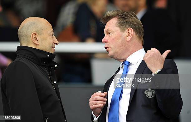 Queens Park Rangers' Chief Executive Philip Beard talks to Arsenal's Greek South African Chief Executive Ivan Gazidis before the English Premier...