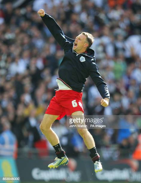 Queens Park Rangers' Clint Hill celebrates victory at the final whistle