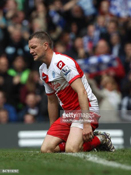 Queens Park Rangers' Clint Hill kneels dejected after they concede a sixth goal