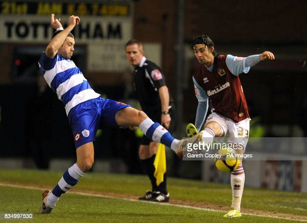Queens Park Rangers' Damien Delaney and Burnley's Chris Eagles battle for the ball