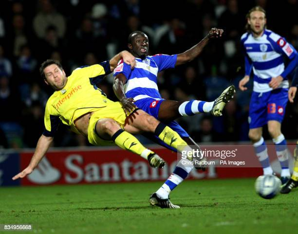 Queens Park Rangers Damien Stewart tussels with Preston North Ends Jon Parkin during the CocaCola Championship match at Loftus Road London