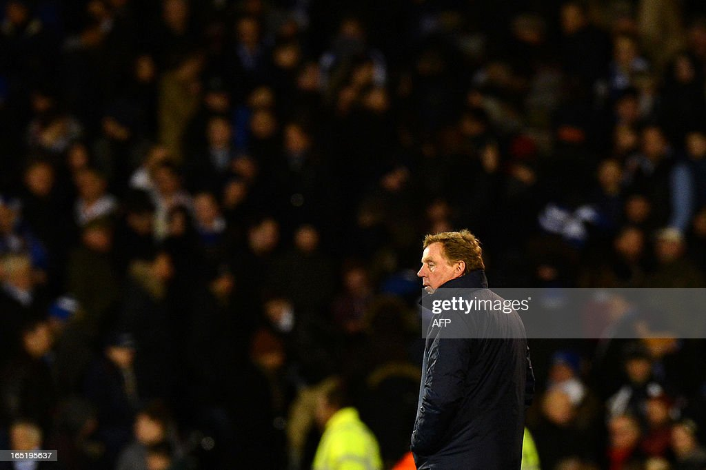 """Queens Park Rangers' English manager Harry Redknapp leaves the pitch after losing the English Premier League football match between Fulham and Queens Park Rangers at Craven Cottage in London on April 1, 2013. Fulham won 3-2. AFP PHOTO / BEN STANSALL USE. No use with unauthorized audio, video, data, fixture lists, club/league logos or """"live"""" services. Online in-match use limited to 45 images, no video emulation. No use in betting, games or single club/league/player publications."""
