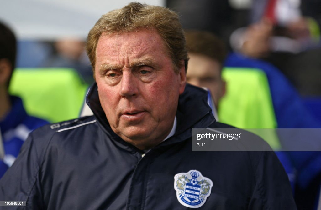 """Queens Park Rangers' English manager <a gi-track='captionPersonalityLinkClicked' href=/galleries/search?phrase=Harry+Redknapp&family=editorial&specificpeople=204768 ng-click='$event.stopPropagation()'>Harry Redknapp</a> looks on during the English Premier League football match between Queens Park Rangers and Wigan Athletic at the Loftus Road Stadium in London on April 7, 2013. The game finished 1-1. USE. No use with unauthorized audio, video, data, fixture lists, club/league logos or """"live"""" services. Online in-match use limited to 45 images, no video emulation. No use in betting, games or single club/league/player publications."""