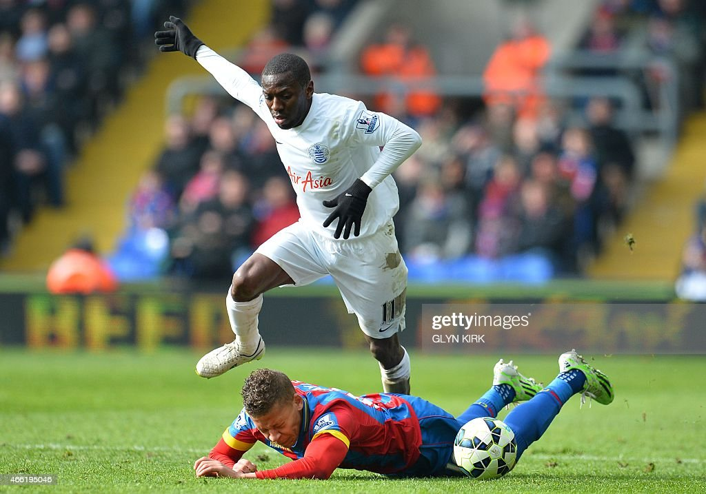 Queens Park Rangers' English midfielder Shaun WrightPhillips vies with Crystal Palace's English striker Dwight Gayle during the English Premier...