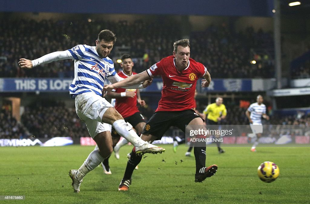 Queens Park Rangers' English striker <a gi-track='captionPersonalityLinkClicked' href=/galleries/search?phrase=Charlie+Austin+-+Soccer+Player&family=editorial&specificpeople=12899527 ng-click='$event.stopPropagation()'>Charlie Austin</a> (L) shoots at goal past Manchester United's English defender <a gi-track='captionPersonalityLinkClicked' href=/galleries/search?phrase=Phil+Jones+-+Soccer+Player&family=editorial&specificpeople=7841291 ng-click='$event.stopPropagation()'>Phil Jones</a> during the English Premier League football match between Queens Park Rangers and Manchester United at Loftus Road Stadium in London, on January 17, 2015. AFP PHOTO/ADRIAN DENNIS PUBLICATIONS. ==