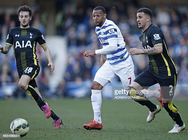 Queens Park Rangers' Englishborn Scottish midfielder Matt Phillips vies with Tottenham Hotspur's English midfielder Ryan Mason and Tottenham...