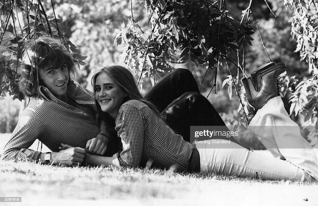Queen's Park Rangers footballer Stan Bowles relaxes with his girlfriend.