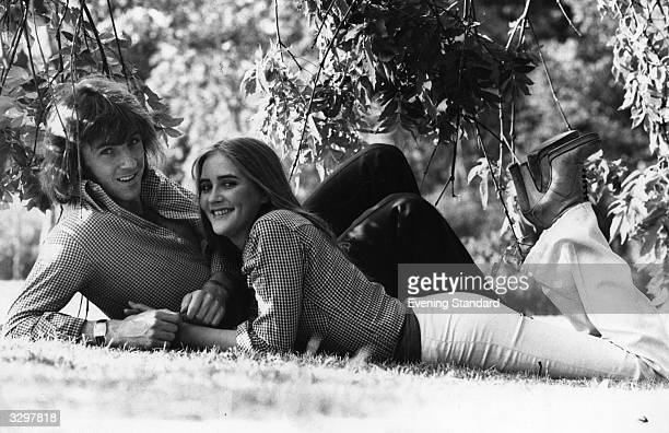 Queen's Park Rangers footballer Stan Bowles relaxes with his girlfriend