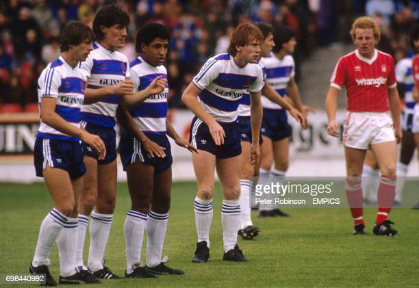 Queens Park Rangers' Gary Micklewhite Simon Stainrod Tony Sealy and Gary Waddock form a defensive wall watched by Nottingham Forest's Ian Wallace
