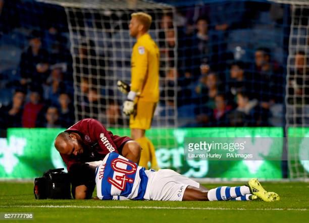 Queens Park Rangers' Idrissa Sylla is treated before being substituted during the Carabao Cup first round match at Loftus Road London