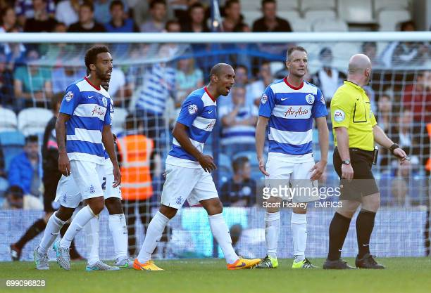 Queens Park Rangers' James Perch Karl Henry and Clint Hill surround referee Simon Hooper after the Cardiff equaliser
