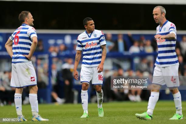 Queens Park Rangers' Jermaine Jenas Shaun Derry and Clint Hill appear dejected
