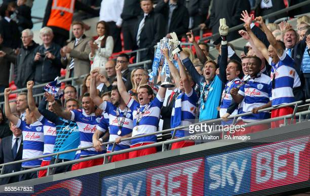 Queens Park Rangers' Joey Barton and Clint Hill lift the Sky Bet Championship Play Off trophy in the stands after the game