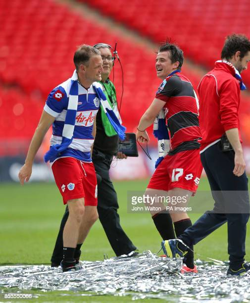 Queens Park Rangers' Joey Barton and teammate Clint Hill celebrate victory on the Wembley turf