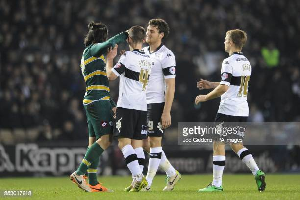 Queens Park Rangers' Joey Barton clashes with Derby County's Craig Bryson during the Sky Bet Championship match at the Ipro Stadium Derby