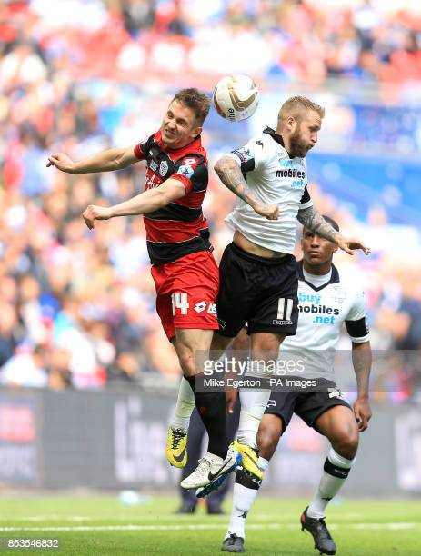 Queens Park Rangers' Kevin Doyle and Derby County's Johnny Russell battle for the ball