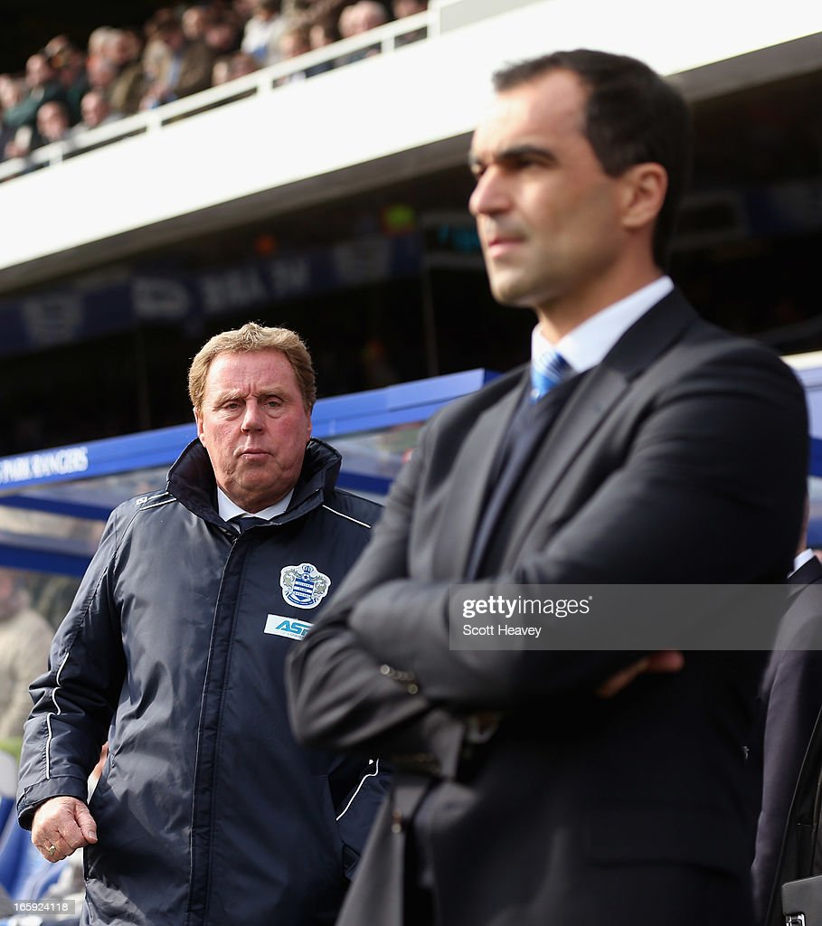 Queens Park Rangers manager <a gi-track='captionPersonalityLinkClicked' href=/galleries/search?phrase=Harry+Redknapp&family=editorial&specificpeople=204768 ng-click='$event.stopPropagation()'>Harry Redknapp</a> and Wigan Athletic manager Roberto Martinez looks on ahead of the Barclays Premier League match between Queens Park Rangers and Wigan Athletic at Loftus Road on April 7, 2013 in London, England.