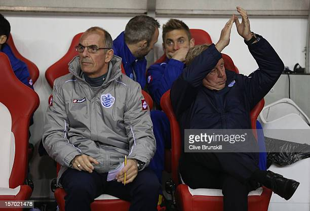 Queens Park Rangers manager Harry Redknapp applauds his new supporters as Joe Jordan sits next to him during the Barclays Premier League match...