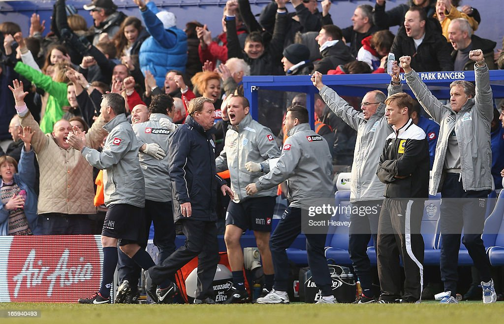 Queens Park Rangers manager Harry Redknapp (third left) barely reacts as his staff celebrate Loic Remy's late goal during the Barclays Premier League match between Queens Park Rangers and Wigan Athletic at Loftus Road on April 7, 2013 in London, England.