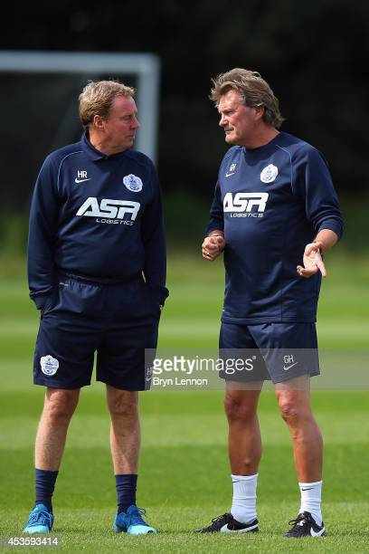 Queens Park Rangers Manager Harry Redknapp chats to new first team coach Glenn Hoddle during a Queens Park Rangers Training Session and Press...