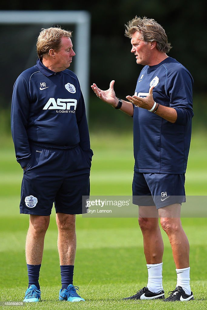 Queens Park Rangers Manager <a gi-track='captionPersonalityLinkClicked' href=/galleries/search?phrase=Harry+Redknapp&family=editorial&specificpeople=204768 ng-click='$event.stopPropagation()'>Harry Redknapp</a> (l) chats to new first team coach <a gi-track='captionPersonalityLinkClicked' href=/galleries/search?phrase=Glenn+Hoddle&family=editorial&specificpeople=217513 ng-click='$event.stopPropagation()'>Glenn Hoddle</a> during a Queens Park Rangers Training Session on August 14, 2014 in Harlington, England.