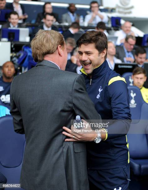Queens Park Rangers manager Harry Redknapp is greeted by Tottenham Hotspur manager Mauricio Pochettino before the game