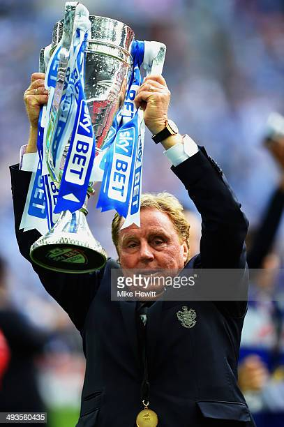 Queens Park Rangers manager Harry Redknapp lifts the trophy after his side wins promotion to the Premier league following their victory in the Sky...