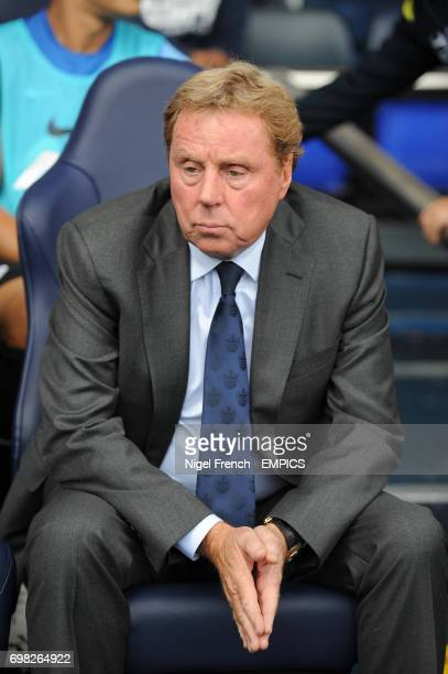 Queens Park Rangers manager Harry Redknapp sat in the away dugout at White Hart Lane