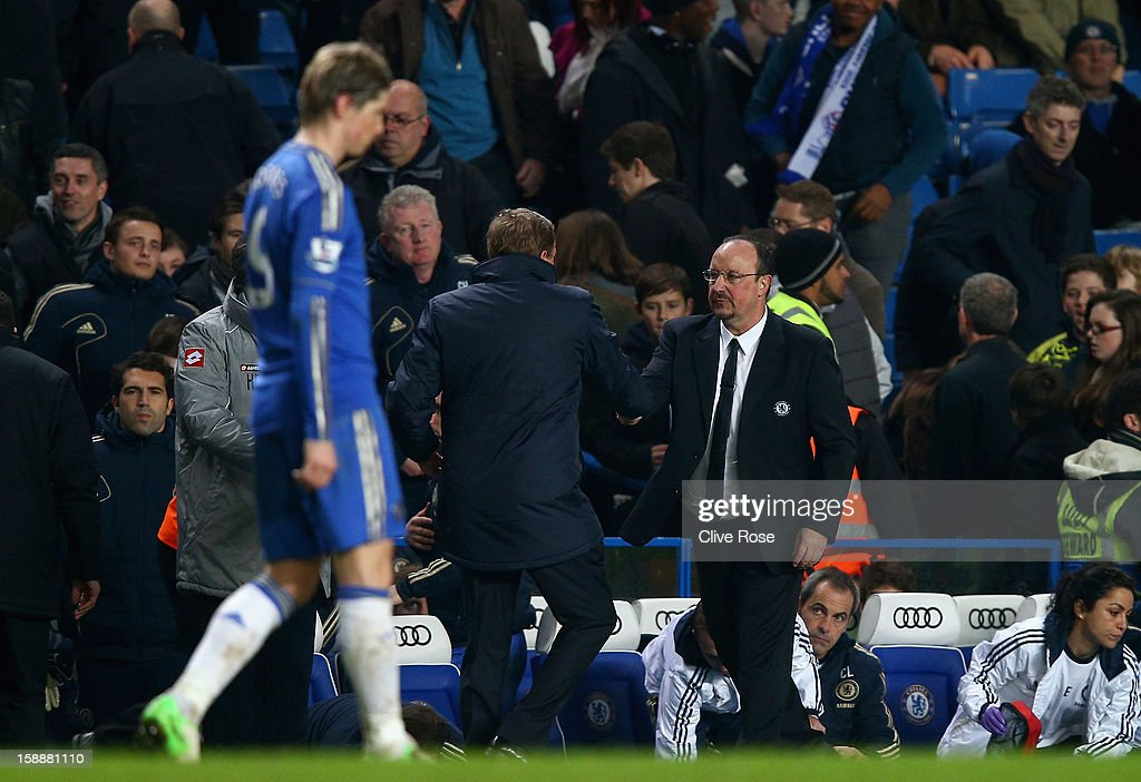 Queens Park Rangers manager <a gi-track='captionPersonalityLinkClicked' href=/galleries/search?phrase=Harry+Redknapp&family=editorial&specificpeople=204768 ng-click='$event.stopPropagation()'>Harry Redknapp</a> shakes hands with a dejected Chelsea interim manager Rafael Benitez after the Barclays Premier League match between Chelsea and Queens Park Rangers at Stamford Bridge on January 2, 2013 in London, England.
