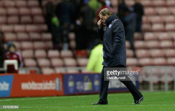 Queens Park Rangers manager Harry Redknapp shows his dejection as he walks off the pitch at the end of his first game in charge during the Barclays...