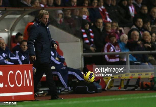 Queens Park Rangers manager Harry Redknapp shows his frustration as he kicks the ball during his first game in charge during the Barclays Premier...