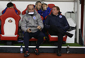 Queens Park Rangers manager Harry Redknapp sits next to his assistant manager Joe Jordan during the Barclays Premier League match between Sunderland...