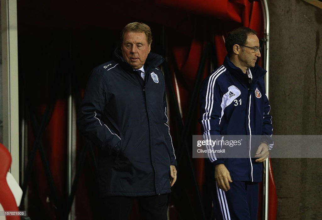 Queens Park Rangers manager <a gi-track='captionPersonalityLinkClicked' href=/galleries/search?phrase=Harry+Redknapp&family=editorial&specificpeople=204768 ng-click='$event.stopPropagation()'>Harry Redknapp</a> walks out for his first match in charge with Sunderland manager Martin O'Neil during the Barclays Premier League match between Sunderland and Queens Park Rangers at the Stadium of Light on November 27, 2012, in Sunderland, England.