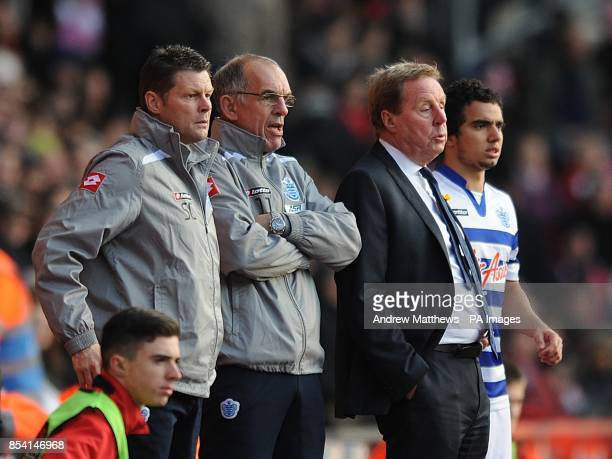 Queens Park Rangers manager Harry Redknapp watches on from the touchline with first team coaches Joe Jordan and Steve Cotterill