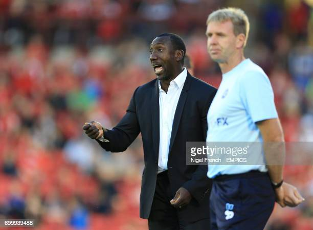 Queens Park Rangers' manager Jimmy Floyd Hasselbaink and assistant David Oldfield during the game against Barnsley